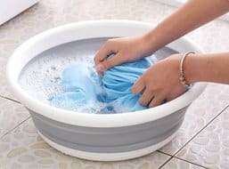 Soak clothes in detergent for pre washing treatment
